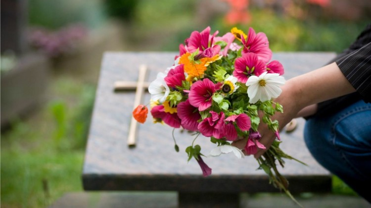 people-put-flowers-graves_17413cefbbf774cb